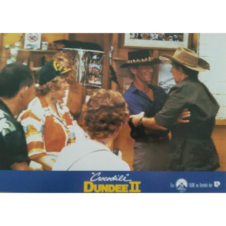 CROCODILE DUNDEE II - Jeu de 18 photos d'exploitation Allemande - 1988 - Paul Hogan / Linda Kozlowski
